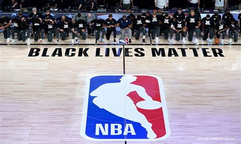 NBA players took a knee before kicking off the league's